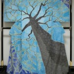 個性的な訪問着樹木トルコブルーとテッセン